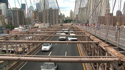 People walking and cars driving on the brooklyn br Stock Video Footage