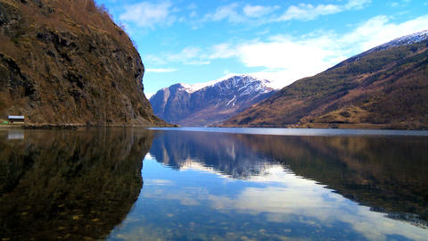 Time-lapse clouds over crystal clear waters of a glacial... Stock Video Footage