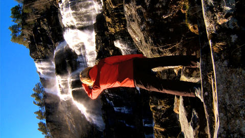 Vertical shot of lone young female fulfilling her ambitions Stock Video Footage
