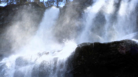 Spray from cascading waters of a powerful waterfall Footage