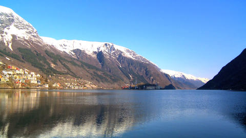 Hillside community & oil refinery beside a beautiful glacial fjord Footage