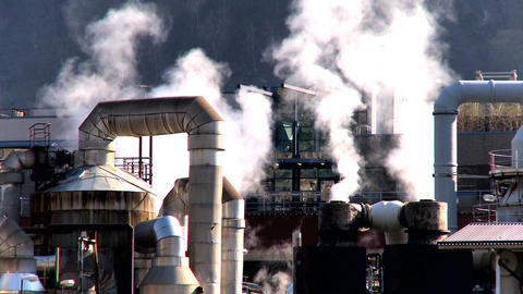 Oil refinery smoke polluting the air in a glacial valley Stock Video Footage