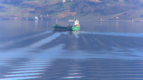 Oil tanker transporting North Sea oil along a glacial fjord Footage