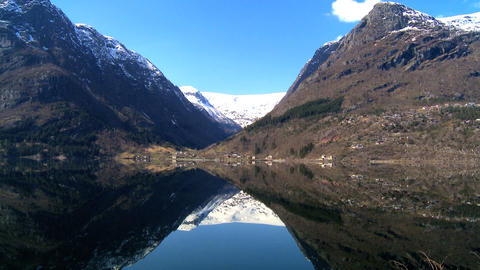 Mirror image of mountains in crystal clear water of... Stock Video Footage