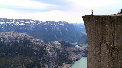 Lone young female on top of the world fulfilling her... Stock Video Footage