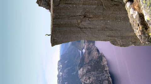 Vertical of lone young female on top of the world... Stock Video Footage