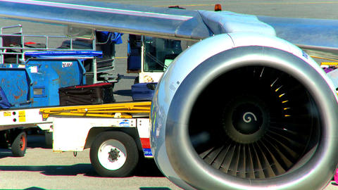 Commercial jet airliner unloading passenger baggage Stock Video Footage
