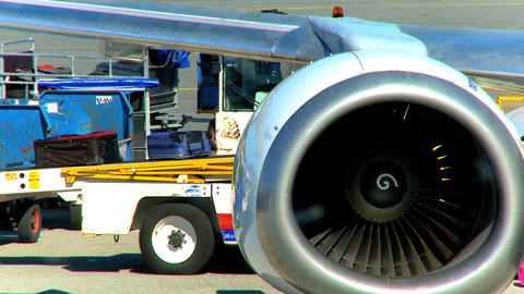 Commercial jet airliner unloading passenger baggage ビデオ