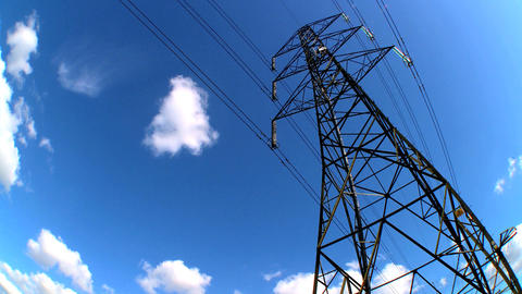 Time-lapse clouds of an electricty pylon looking skyward Footage