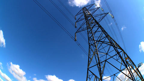 Time-lapse clouds of an electricty pylon looking skyward Stock Video Footage