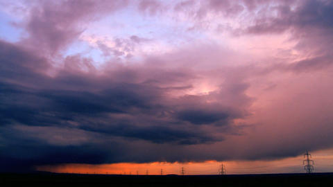 Time-lapse storm clouds at sunset over a horizon full of... Stock Video Footage