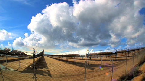 Time-lapse clouds over cluster of solar energy producing... Stock Video Footage