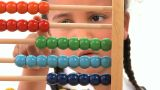 Cute African American Schoolgirl Early Learning Counting With An Abacus stock footage