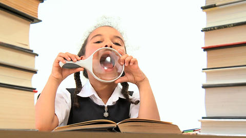 Cute african american schoolgirl using a spy glass with a... Stock Video Footage