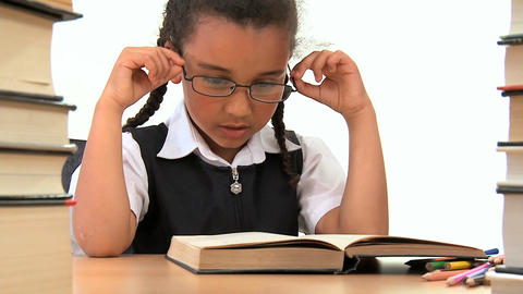 Cute african american schoolgirl early learning with a book Footage