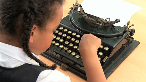 Cute african american schoolgirl using an old fashioned... Stock Video Footage