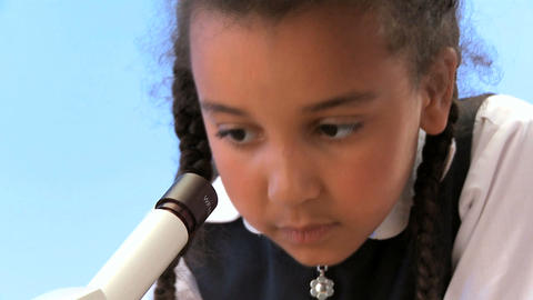 Cute african american schoolgirl with teacher learning elementary science Footage