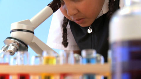 Cute african american schoolgirl early learning elementary science Footage