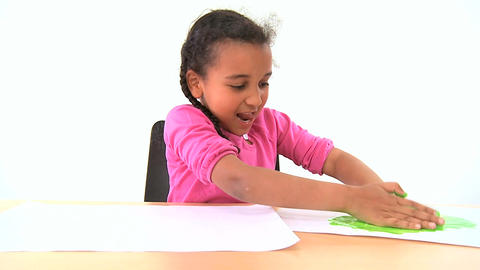 Cute african american child early learning with hand painting Footage