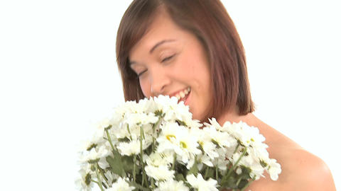 Young western oriental girl enjoying the therapeutic pleasure of flowers Footage