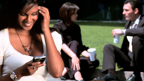 Young city business woman,relaxing outdoors with colleagues Footage
