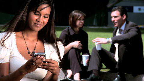 Young city business woman,relaxing outdoors with colleagues Stock Video Footage