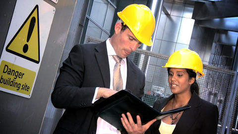 Young graduate engineers with modern city construction plans Stock Video Footage