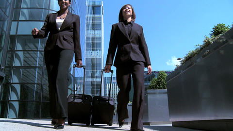 Smart young city business women preparing to travel from... Stock Video Footage