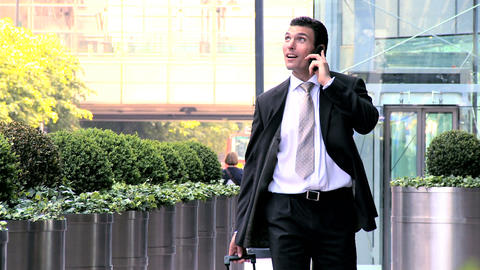 Smart young city businessman preparing to travel from... Stock Video Footage