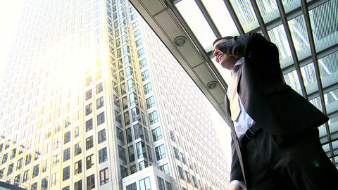 Ambitious young city businessman celebrating good news on... Stock Video Footage