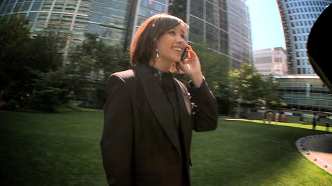 Young city business woman talking on mobile(cell) phone... Stock Video Footage