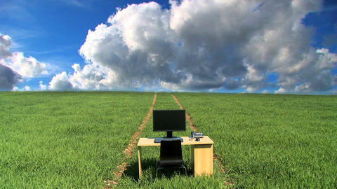 Modern technology in a conceptual office without wallswith t/lapse clouds Footage