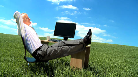 Businessman in environmental workplace daydreaming of a brighter future Footage