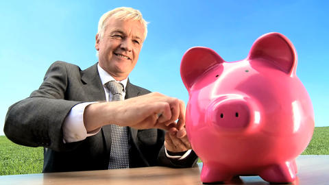 Businessman using money pig for green investment in an... Stock Video Footage