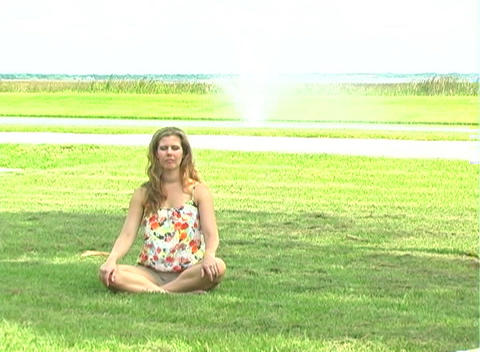 Beautiful Blonde Meditating Outdoors-1 Stock Video Footage