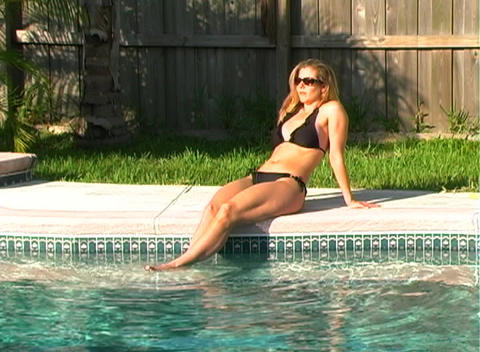 Beautiful Blonde in a Black Bikini Poolside-1a Footage