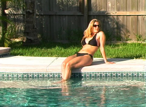 Beautiful Blonde in a Black Bikini Poolside-1a Stock Video Footage