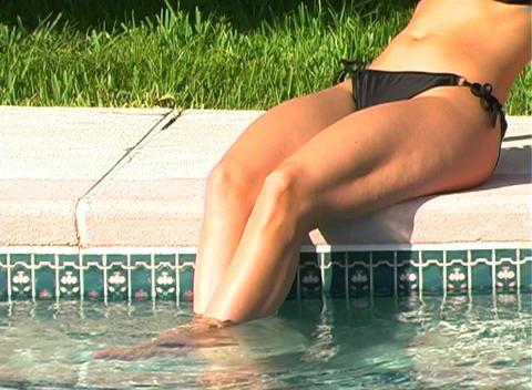 Beautiful Blonde in a Black Bikini Poolside-2 Stock Video Footage