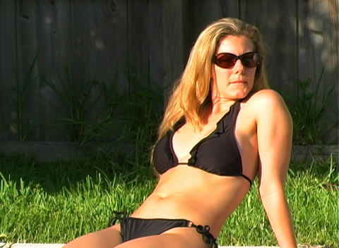 Beautiful Blonde in a Black Bikini Poolside-2 Footage