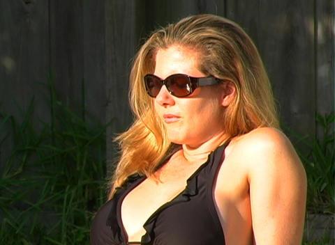 Beautiful Blonde in a Black Bikini Poolside-4 Stock Video Footage