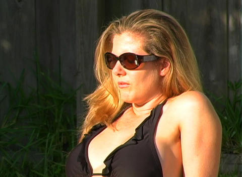 Beautiful Blonde in a Black Bikini Poolside-4 Footage