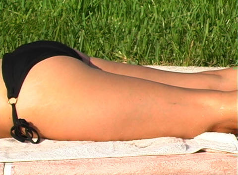 Beautiful Blonde in a Black Bikini Poolside-6 Stock Video Footage