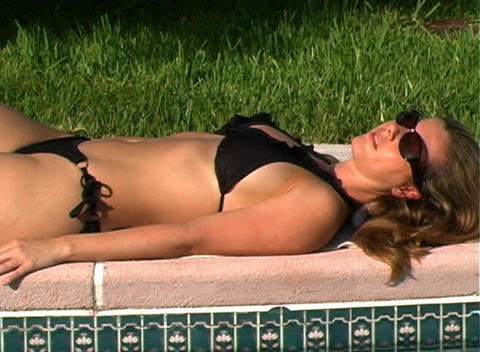 Beautiful Blonde in a Black Bikini Poolside-10 Stock Video Footage