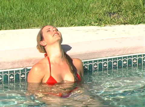 Bikini-clad Blonde Dives into a Swimming Pool-1 Footage