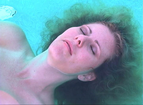 Beautiful Blonde Floating in a Pool-2 (slow motion) Stock Video Footage