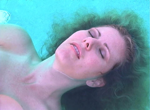 Beautiful Blonde Floating in a Pool-2 (slow motion) Footage