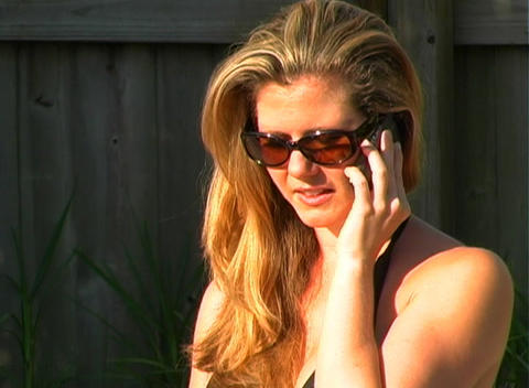 Sexy Blonde with Cell Phone Poolside-3 Stock Video Footage