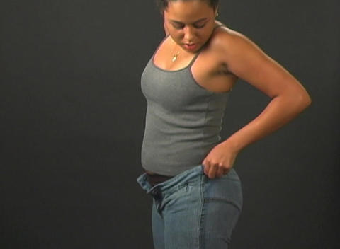 Putting on Her Jeans - Profile View Footage