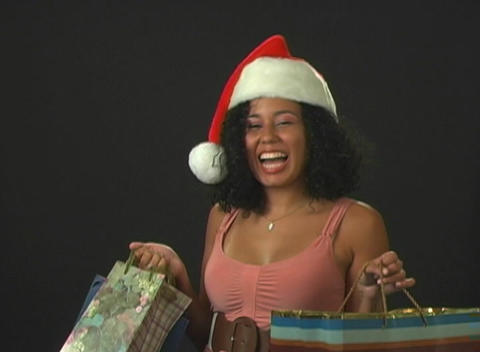 Beautiful Young Santa's Helper with Shopping Bags Stock Video Footage