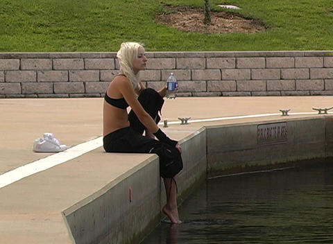 Beautiful Blonde Resting Outdoors Footage